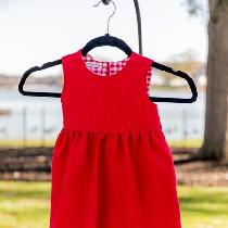 A little girl's Christmas dress made from Crimson heavyweight linen and lined with cotton.  I ad...