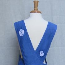 Back view of Indigo dyed Shibori embellished apron/overdress in midweight linen.