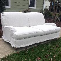 Sofa slipcover with baby knife pleats.
