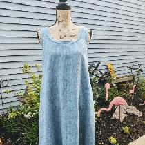 Asymmetrical hemmed dress with raw edged bias trim on neckline and armholes. 100% Linen SunRags...