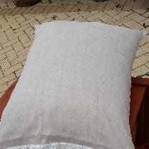 This is a French seam pillowcase in beige linen and vintage lace.