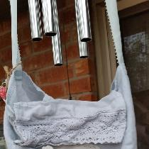 Baby blue linen tote/purse embellished with a cotton embroidered doily and crochet lace.