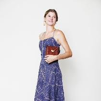 Linen Picnic Dress: Plum linen printed with discharge paste to remove dye in a spiraling pattern...