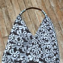 The bag, silhouette is based on a Japanese design, is made of fabric that has been designed and...