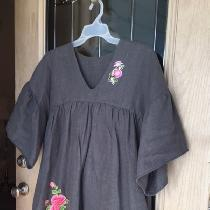 Grey Linen Dress with sewn-on appliques. This dress is easy to wear and fully lined. It has been...