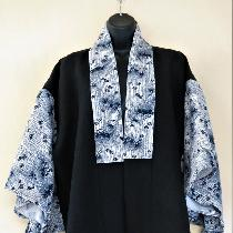 Kimono jacket made with ILO19 Black linen for the body combined with a Japanese yukata cotton fo...