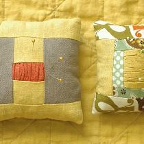 Pincushions made from linen solids and a cotton print.