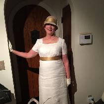 This is a mid-weight/hankerchief linen dress I made for an Edwardian dinner party.  It has an un...