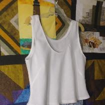 The Nico camisole, neck and armhole edges finished with Piped Bias - hanging over a quilt in pro...