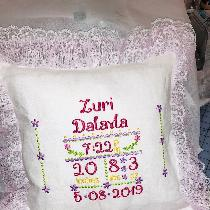 Embroidered Biirth Announcement pillow. Made with opti white linen and pink lace for my great ni...