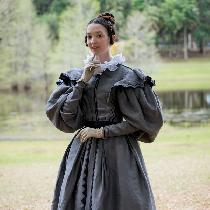 "This 1830's grey ""grisette"" dress is made with mainly grey linen and black cotton sateen. The dr..."