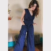 This is a self-drafted 100% linen jumpsuit with attached waist ties and patch pockets. It has a...