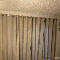 Lined Grommet Curtain for the family room sliding door. Made with the natural linen 4C22. Covere...