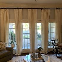 Pinch pleated linen drapes with hand sewn seams. They measure 107 inches long and were made usin...