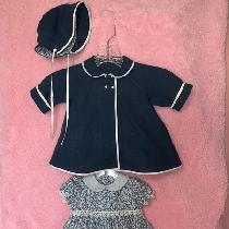"I made this little doll outfit using remnants from a dress I made with ""insignia blue"" linen. Li..."