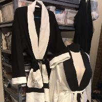 This is a his and hers set of Housecoats and sleep pants, mix of white and black linen.  J and J...
