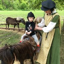I sewed this outfit specifically for easy nursing while I worked the Ren Faire as a minstrel. Th...