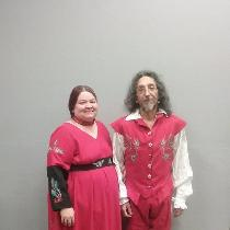 reenactment category.  the woman's dress and the man's 16th century outfit are made of red linen...
