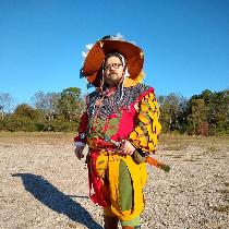 This is a German Landsknecht outfit I made for the Ren Faire (me in picture). It was handsewn fr...