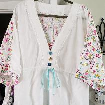Drawstring tunic top. Signature finish linen with cotton print for back yoke and sleeves.
