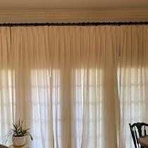 Pinch pleated linen drapes with hand sewn seams. Made with IL019 Tadelakt.