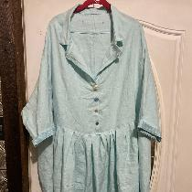 A Tina Givens tunic/dress pattern made with Moonflower 019 softened linen.  Love the color, even...