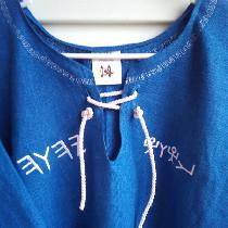 On Royal blue linen. T-tunic top with embroidery and rope tie at neck.