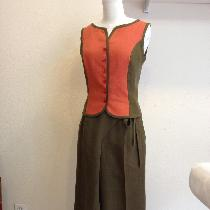 Coordinated sleeveless top and cropped wrap-front pants made in mid-weight linen.  Both pieces a...