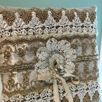 I made this ring pillow for my Niece's wedding. 4C22 natural. Layered will a lot of lace. She lo...