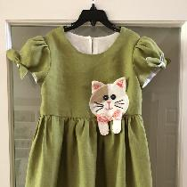 Cat dress for my grand daughter using a Simplicity pattern.  IL019 Oasis Softened fabric was so...
