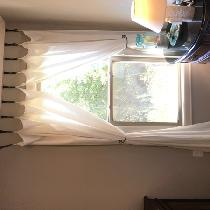 I made curtains with tab tops and used hooks from Hobby Lobby with forged iron tiebacks. Love th...