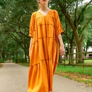 Maxi length dress with v-neck, 3/4 sleeves and tiered panels.