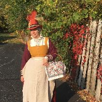 My Autumn Leaves Elizabethan kirtle reminds me of fall colors.  The red skirt and gold bodice ar...