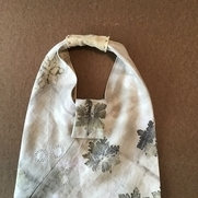 Tessa's triangle bag - shibori with dye made from marigolds with iron; eco-print geranium leaves...