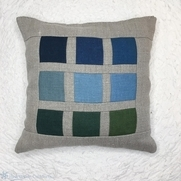 This color chart linen pillow is made with color blocks of IL019 and the natural fabric is IL037...