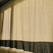 Lined panel drapes with a stripe of indigo kasuri.  I normally prefer floor to ceiling but these...