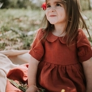 This beautiful dress that I made for my granddaughter is made in the 100% linen spice softened....