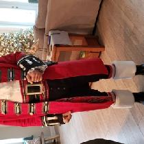 I  made a Santa Pirate coat. This gentleman wanted to be a Christmas Pirate. Crimson linen,  wit...