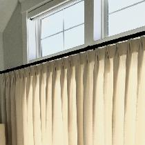 Traversing, euro-pleated,  linen blend draperies on a decorative iron rod.
