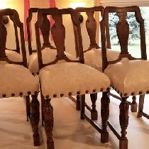 Antique dining chairs. Inner springs were retied and chairs were covered in a leather-like vinyl...