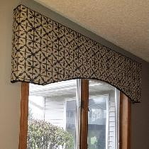 Decorative upholstered cornice for a guest room.