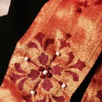 Detail work on collar, dupioni silk on linen. Garment is 12th century bliaut. Pattern painted wi...