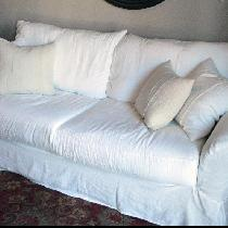 I made a crisp, white sofa cover out of the bleached, softened all purpose linen. I added 2 enve...