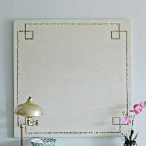 Custom made linen wrapped corkboard with nail heads in a reverse greek key design!
