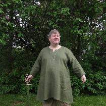 Viking men's tunic with blanket stitch embroidery at the neckline and sleeve.  This project was...