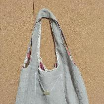 This is a little bag I made out of natural medium weight linen.  I added antique lace and an old...