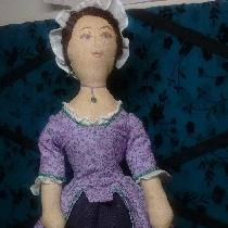 This lavender lady is a 16 inch, 18th Century doll. Her body is tea dyed linen. Her face is hand...