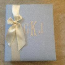blue linen baby book with an ivory monogram and satin ribbon.  We love making our baby books out...