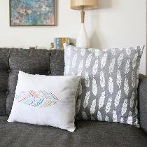 I used grey linen and screen printed my white feather pattern on it to make 18 x18 pillows for m...