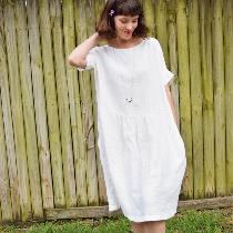 Gathered dress w inseam pockets and cuffed sleeves made with heavy weight bleached.